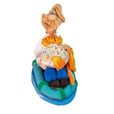 Статуэтка Рыбак с большой рыбой в надувн. лодке